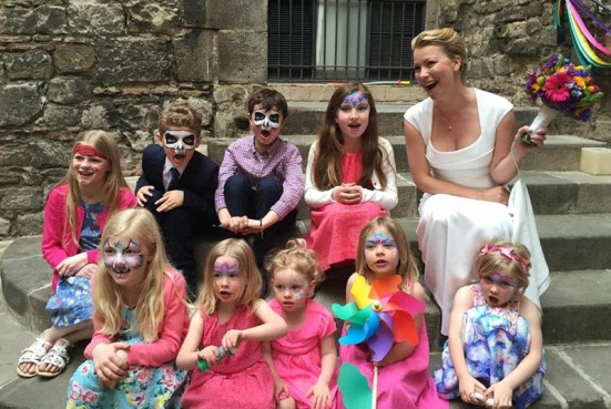 photo of all the kids and the bride